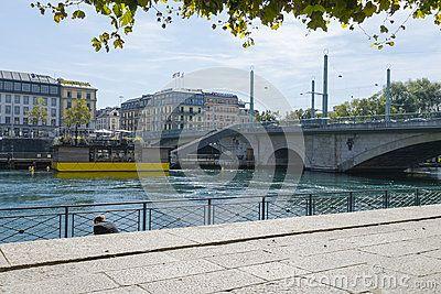 River and bridge in the center of Geneva .Batiment des Forces Motrices, Geneva cultural centre. Switzerland