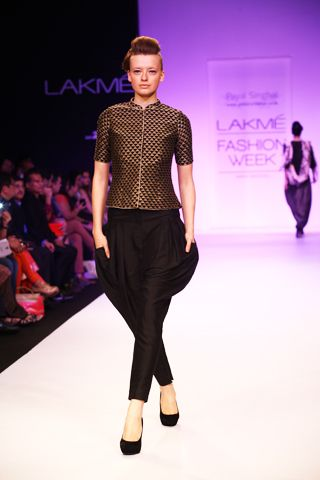 Black Embroidered Sherwani Blouse worn with Black Jodhpurs. Shop The Look at http://www.payalsinghal.com/off-the-runway/sartaj-suit