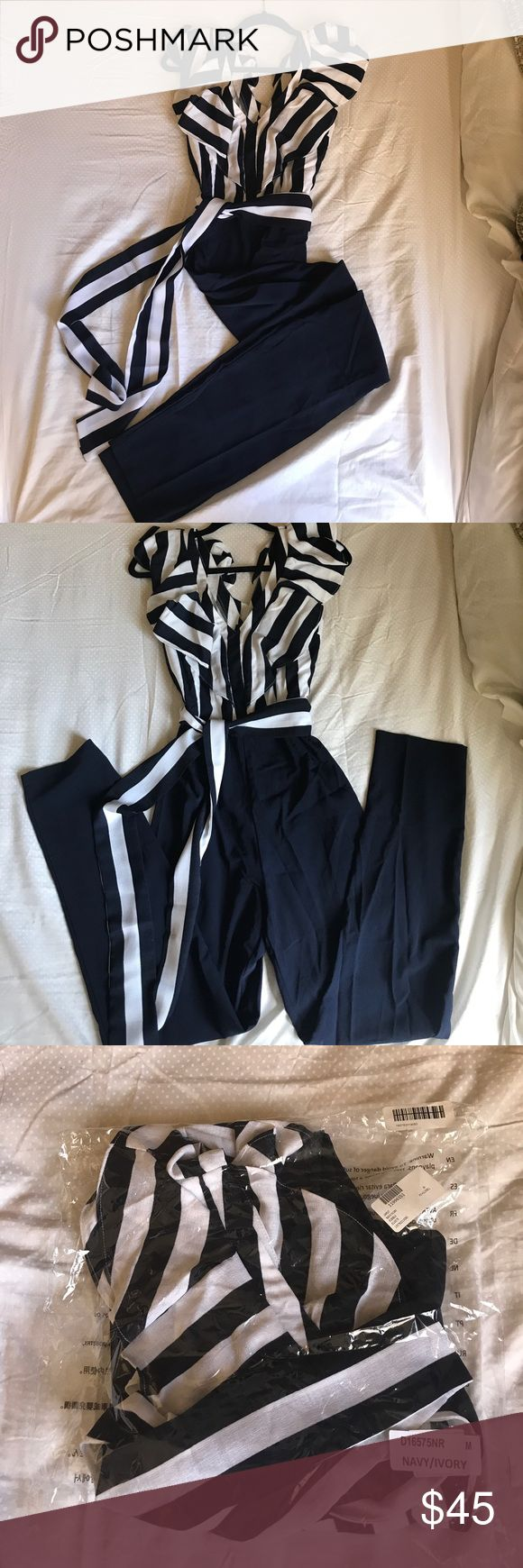 Soieblu Navy and White Striped Jumpsuit Brand New Never Worn! Has only been taken out of the bag to try it on and take a picture.  SO SO cute but it's too small for me!!!   Size medium long jumper.  From Nordstrom Rack online. Soieblu Pants Jumpsuits & Rompers