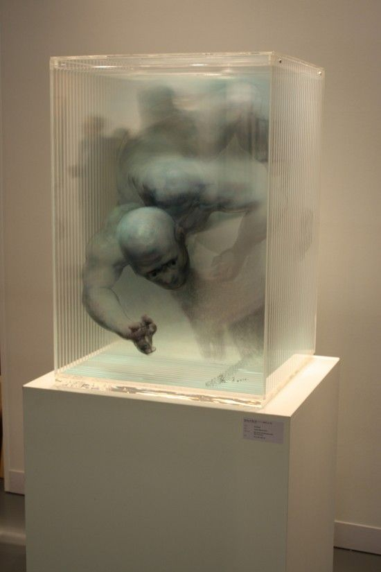 Xia XiaoWan creates paintings layering glass panels of one painting on top of another to create a 3 dimensional work.