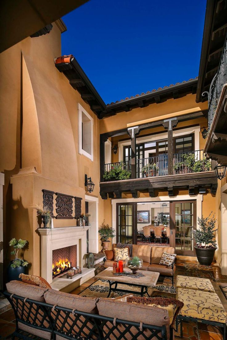 Southwestern Courtyard With Outdoor Fireplace