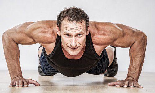 muscular man doing push ups
