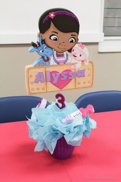 Cute centerpieces at a Doc McStuffins girl birthday party!  See more party ideas at CatchMyParty.com!