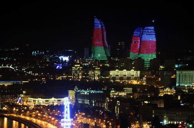 """Baku Night Tour Explore night view of Baku city during """"Baku Night Tour"""". See panorama of the city and enjoy a walk in the city boulevard. You will get a chance to see old parts of the city as well as modern buildings located nearby. You will see the Flame Towers and the city bay panorama along with Martyrs Lane; after you will cross the boulevard to see the Maiden Tower that will make your tour superb and memorable. The last stop will be Tosca restaurant where you will taste ..."""