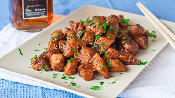 Jo's Bourbon Chicken: marinade of bourbon, soy sauce, water, garlic, brown sugar, ground ginger, white wine, and sesame oil. Let marinade awhile, and then cook in a skillet.