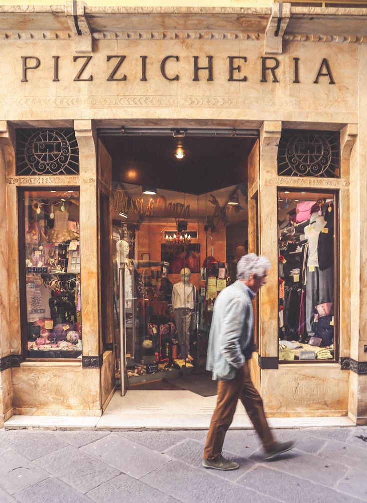 Pizzicheria old sign travel blogger Lucca Tuscany