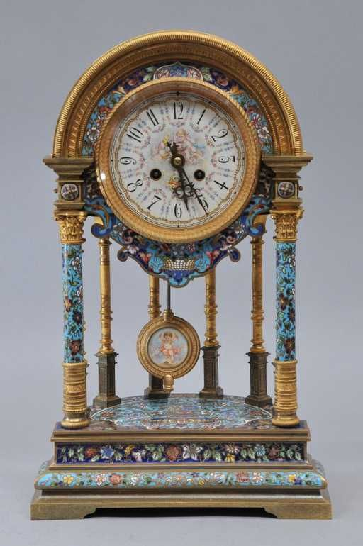 Lot: A massive French Champleve mantle clock. The bronze, Lot Number: 0215A, Starting Bid: $750, Auctioneer: Tremont Auctions, Auction: Fall Fine Art & Antiques Auction, Date: November 19th, 2017 EST