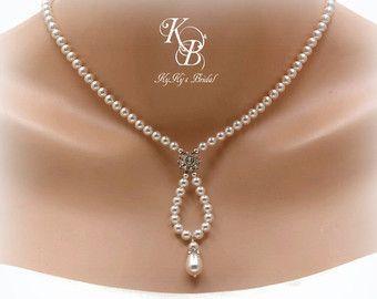 Do starfish pendant at top and silver starfish charm at bottom