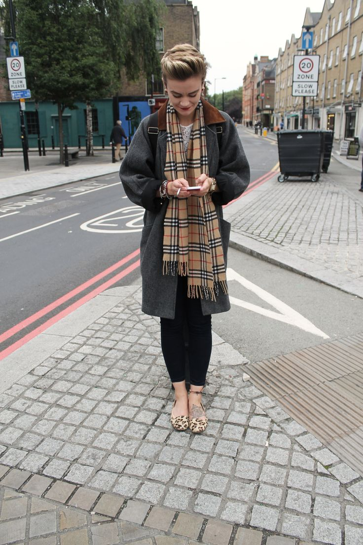 Teaming a masculine coat with a Burberry  scarf never looked so feminine. Shoreditch Style