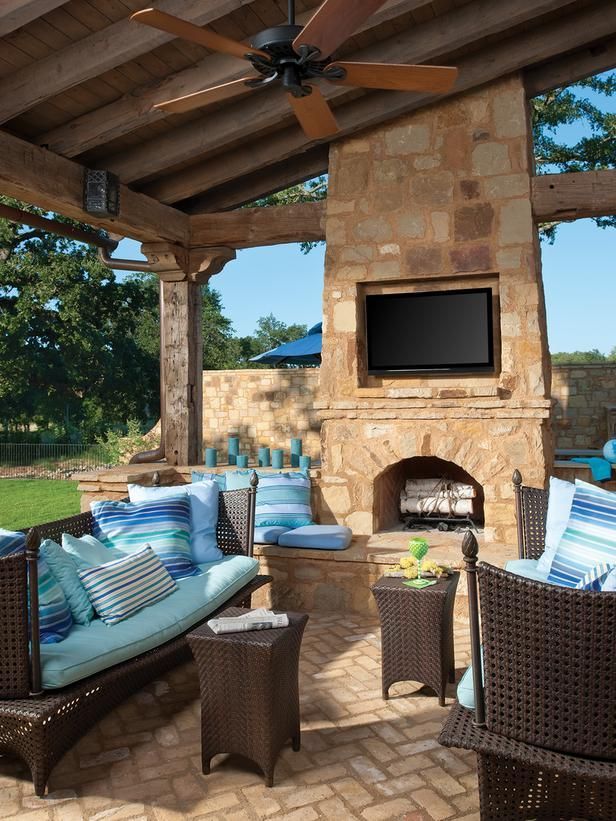 Love the Blue & roof & fireplace & TV...love it all. Mediterranean Outdoors HGTV
