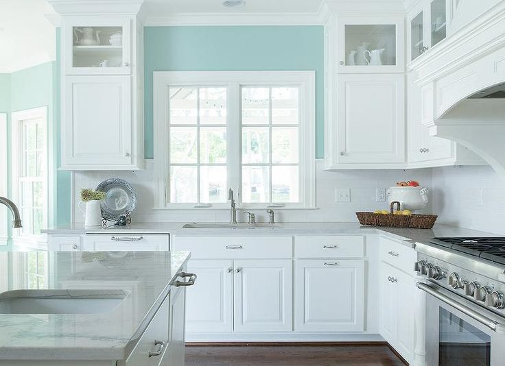 White and turquoise kitchen features walls painted
