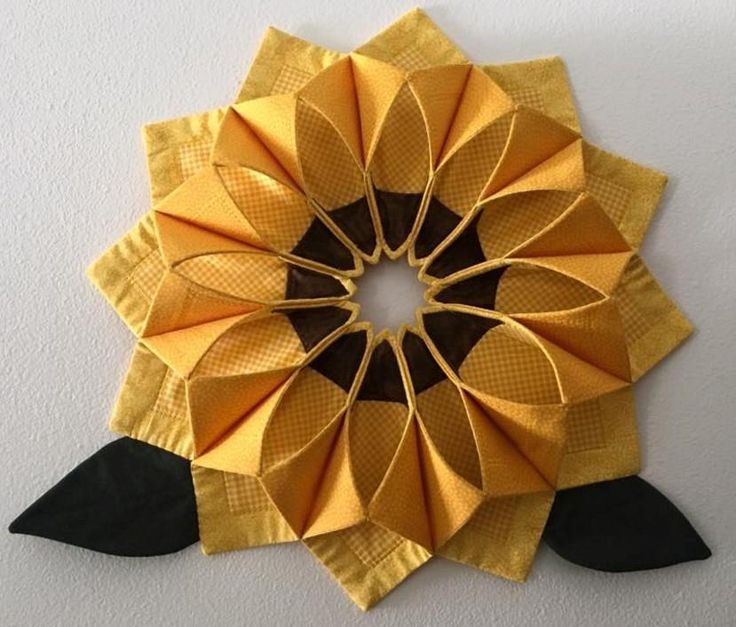 Fold 'n Stitch Wreath for all seasons depending on fabric choice.  Lots of examples here.