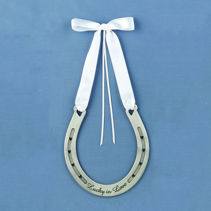 "Cute decoration idea or as an alternative to the ring pillow. The Wedding Ring Horseshoe with ""Lucky in Love"" engraved on it."