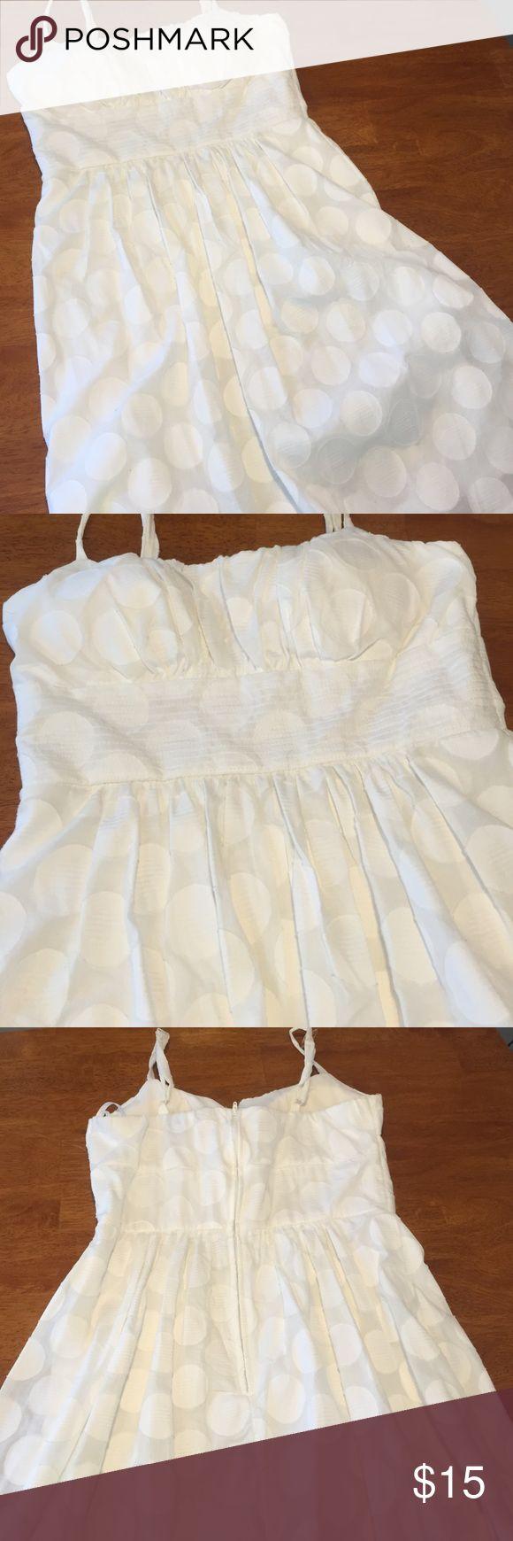 White polka dot dress Double layered white polka dot dress. Thick waistband. Padding in the boobs. Adjustable straps. Great graduation dress. No trades sorry. B. Smart Dresses Mini