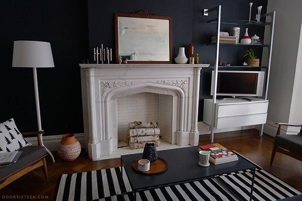 Living Room Black Accent Wall White Fireplace Wood