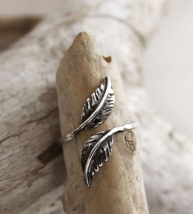 Sterling silver feather wrap ring. slightly oxidized to bring out every small detail.