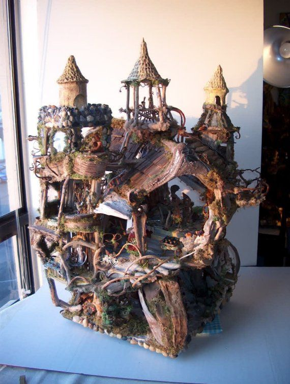 *the fairy castle*.........by *sunflowerhouse* on etsy......you REEEEEEEALLY NEED to click through to SEE more photos and read about these WILDLY creative fairy houses made of all natural materials!!!! oh........and to see the prices!!!!! LOL!!! :-)