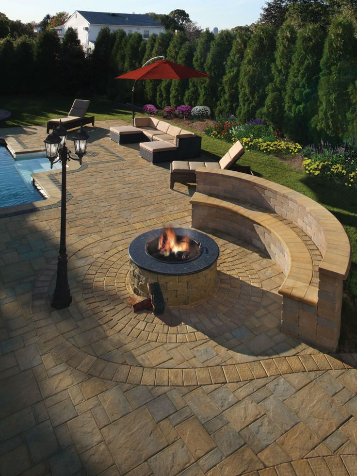 Cambridge Pavingstones with Armortec backyard. This features a pool patio…