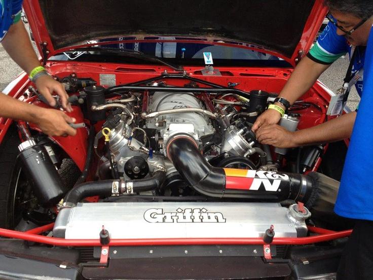 Formula Drift Racer Dai Yoshihara's engine bay, sportin' a K & N intake system.