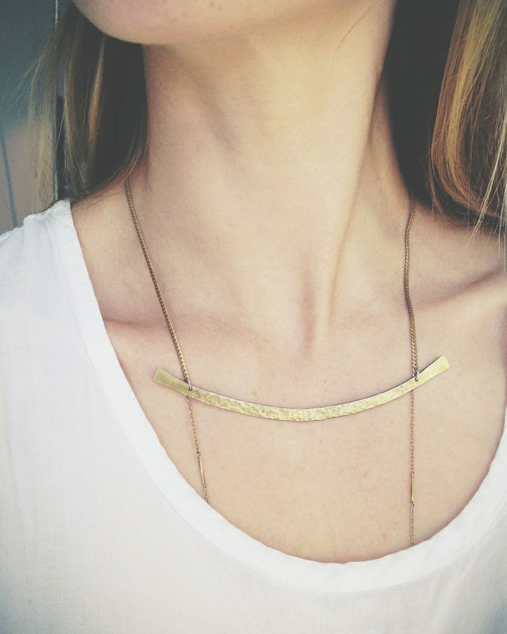 Hammered brass arc with second tier of segmented brass chain suspended underneath.  Wear the chain over or under shirt.