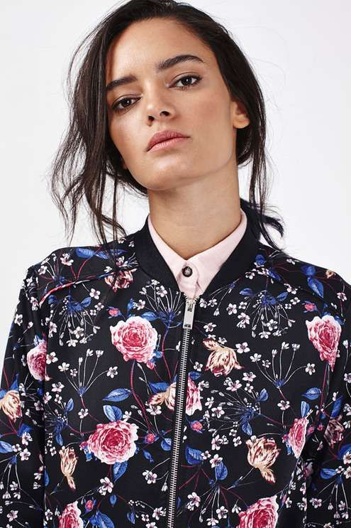 Go girlie in this cool floral print bomber with sporty undertones. We love this paired with ripped jeans and a cool cap for an edgy touch. #Topshop