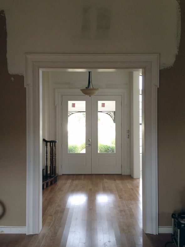 eared architraves really help visually widen and open up a passage surround. such amazing trim. via little green notebook