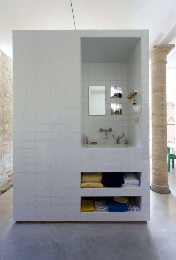 Tile and Concrete compact bathroom. Shower on reverse side of sink. Entry to toilet on the side. Great design concept for not only an indoor bathroom, but also an outdoor bathroom.