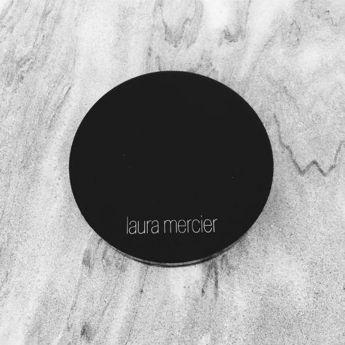 Laura Mercier Bronzed Butter Face & Body Veil on marble.