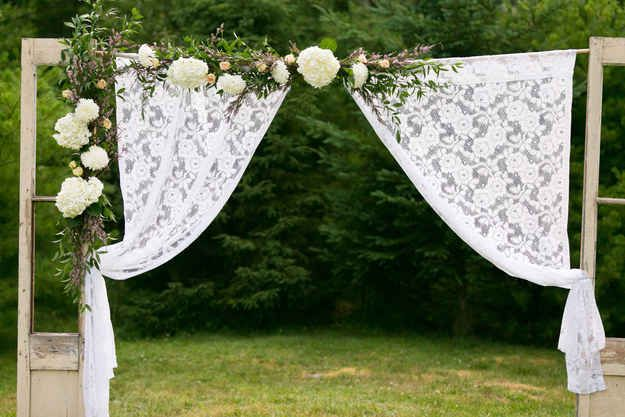 Transform the reception into something spectacular with just fabric and curtains.