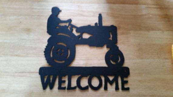 Old Man on Tractor Welcome Sign. Handcrafted in metal with plasma cutter. Not machine cut. Protected with weather resistant paint. Can be left natural without paint. Will rust.
