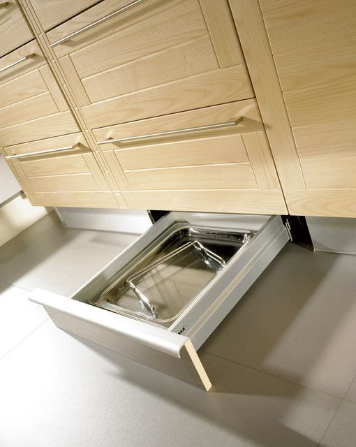 """""""Kick drawers provide much-needed storage space without intruding into the overall design of the kitchen. Narrow drawers underneath the cabinetry provide storage for narrow items such as cooking and pizza trays. These drawers are quite unique and are comfortably accessible with a gentle kick, keeping all trays inside neat and organized."""" ~svea"""