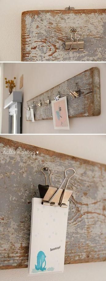 "Hang all your favorite postcards, pictures and memories. Made from rustic reclaimed barn wood. Includes hanging clips. 28""   Display accessories not included."