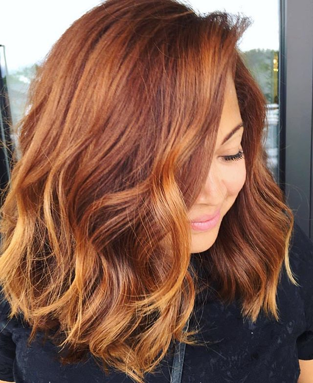 """This color is  for the fall! It's being coined """"pumpkin spice"""" hair - and we are OBSESSED. Looking to change things up with the new season?! Look no further. #repost @salonjosephkenneth #pumpkinspicehair #fallhair"""