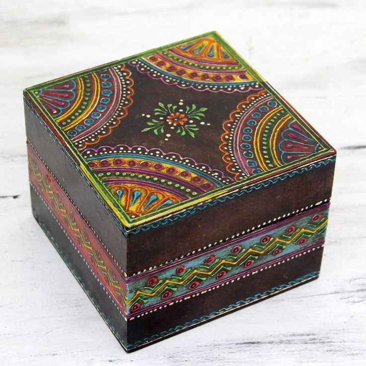 Rachna from India presents a small decorative wood box, hand-painted with festive colors and elaborate designs. She gives the wood box a slightly aged finish for an antique look.