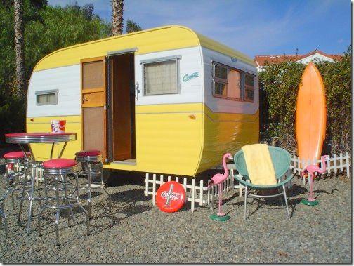 Vintage sunny yellow camper trailer | http://cotedetexas.blogspot.com/2011/10/glampingtrailer-style.html#