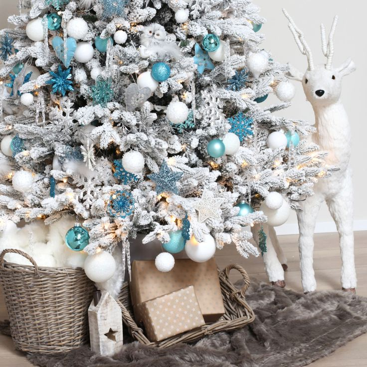 Frozen Christmas Tree Beautiful Christmas Tree decorated with balls and ornaments in ice blue, teal blue, light blue, silver and white | kerstversiering.nl