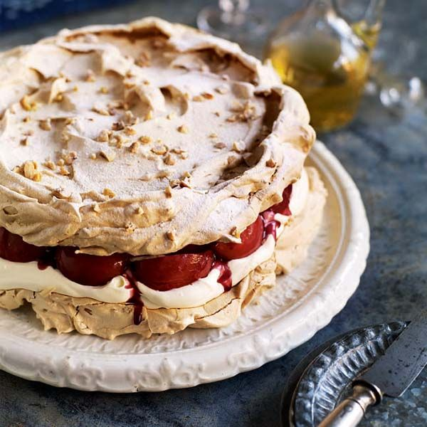 This is an indulgent meringue cake that's creamy in the middle and crisp on the outside – complemented perfectly by the sweet mulled wine pears.