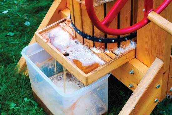 Fashion a DIY apple cider press so you can learn how to make apple cider.