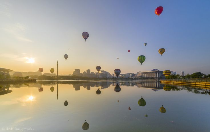 https://flic.kr/p/TK1Zth | An almost perfect reflection of an almost perfect syncronization of flying hot air balloon | Sharing a frame from my time lapse sequence I took during the Myfiesta Hot Air Balloon 2017 Mass Ascension in Putrajaya last month.   HAK Imageworks / © All rights reserved. Do not use or reproduce this image on websites, blogs or publications without expressed written permission from the photographer. The image and timelapse is available for licensing by contacting the…