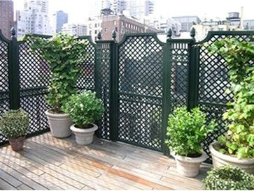 Outdoor wood privacy trellis provides just enough coverage.