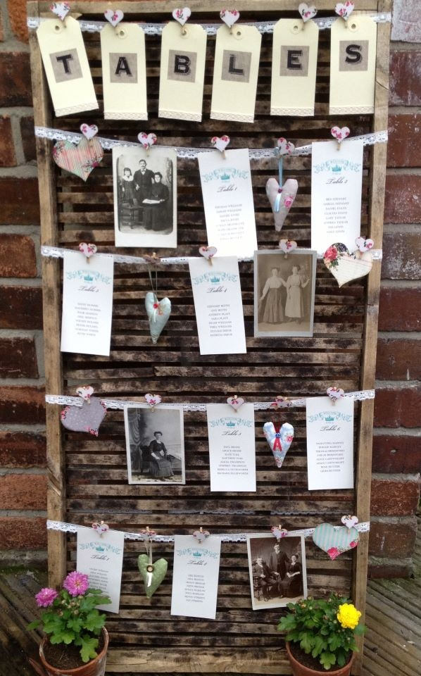Photo rather than numbered wedding tables with a cute hanging table plan idea