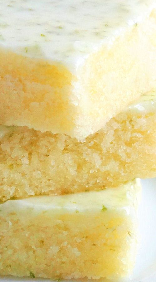 Key Lime Brownies ~ Fudgy, bursting with Key Lime flavor and irresistible! The texture of these citrus bars is very similar to brownies and tasting the glaze gives one the sense of being in the tropics. Perfect for summer entertaining and picnics! Includes gluten free option. | Cinco de Mayo bar dessert recipe