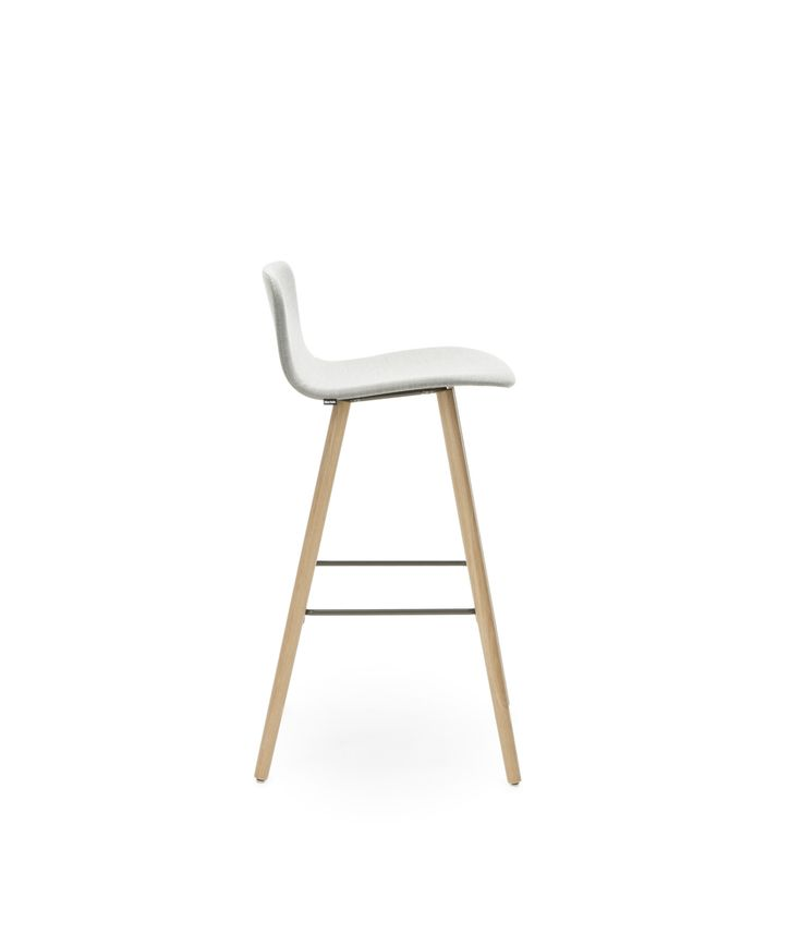The wooden legs of Sola bar stool create a warm and cozy feeling and the stool is available with two different seat and backrest height options. Design Antti Kotilainen