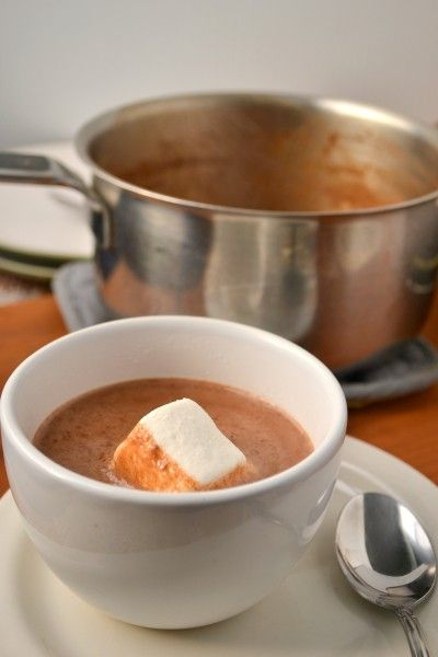 Pumpkin hot chocolate made with almond milk, maple syrup, spices and homemade pumpkin puree.