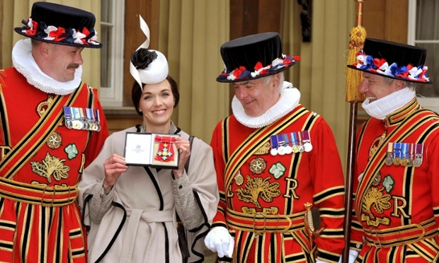 Olympic cyclist Victoria Pendleton honoured at the Investiture Ceremony at Buckingham palace receiving a CBE (Commander of the British Empire) award.