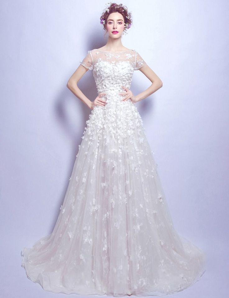 Exquisite Short Sleeved Satin and Organza Wedding Dress has a flattering Sweetheart Neckline with an illusion bodice