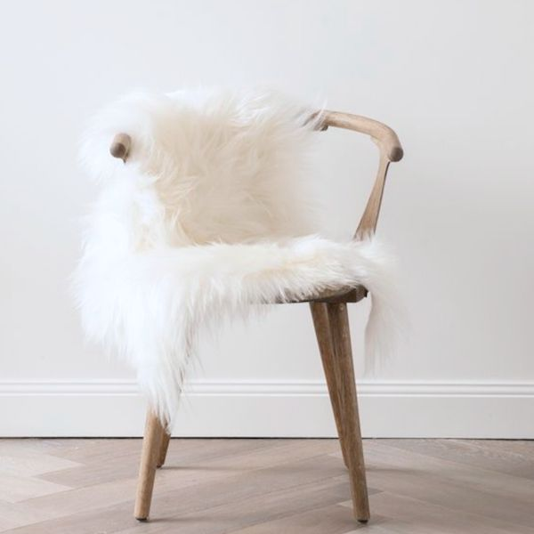 SAME DAY DELIVERY DOES NOT APPLY FOR THIS PRODUCT. Add some luxury to your office or dining room with this soft faux fur chair cover.  Type: Chair Cover or Floor Rug Size: 115cm x 75cm Super Soft Faux Fur Material: Faux Fur Colour: White Non Slip Backing