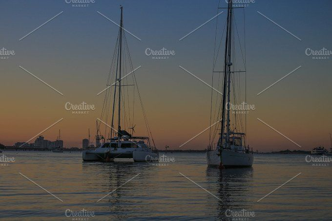 Boats under the sunset by NotJustVisual on @creativemarket