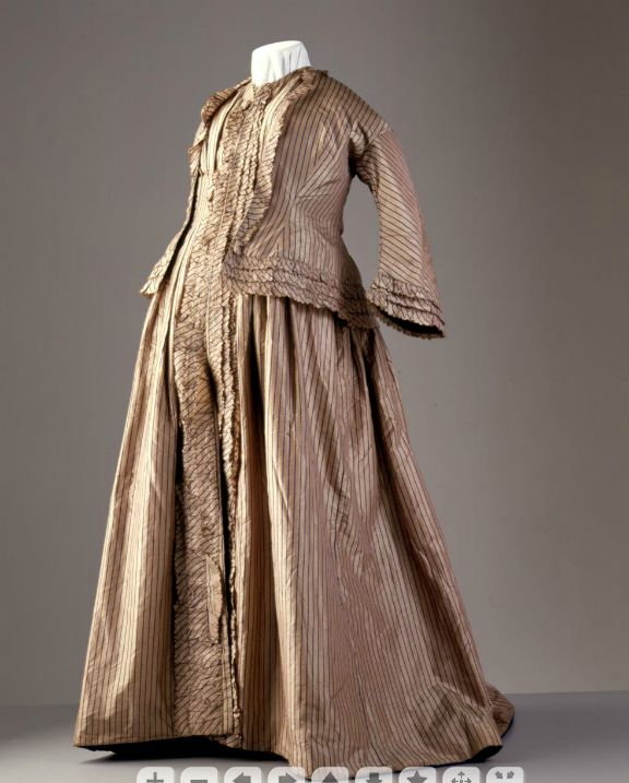 Her dress had a less fitted front that allowed for her expanding abdomen. 1858-60 maternity dress