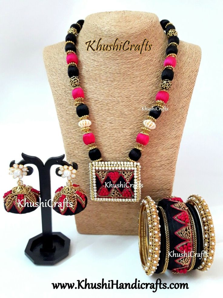 Pink and Black Raw Silk/Silk Thread Jewelry Set with Jhumkas and raw silk Bangles-Handmade Indian Jewelry  This jewelry listing set consists of one necklace which is made of Black and Pink silk thread wrapped beads with Pearl bead spacer and a pendant crafted in raw silk. The matching Jhumkas with raw silk bangles compliment this neck-piece.